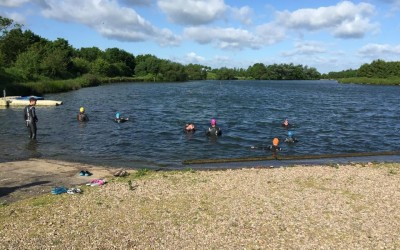 race hub swimmers in water